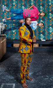 "Kehinde Wiley at his Williamsburg, Brooklyn, studio with his painting ""Jose Alberto de la Cruz Diaz and Luis Nunez"" (2013). Credit Chad Batka for The New York Times"